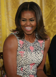 Michelle Obama amped up the sweetness with a pink lip.
