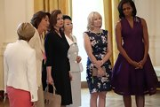 Michelle Obama looked darling in a wine-colored fit-and-flare dress while giving the G-8 spouses a tour of the White House.