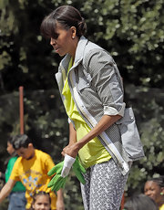 Michelle rolled up the sleeves of her striped utility jacket for a gardening event at the White House.