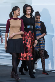 This maroon and camel colored sweater looked elegant and academic on Malia Obama.