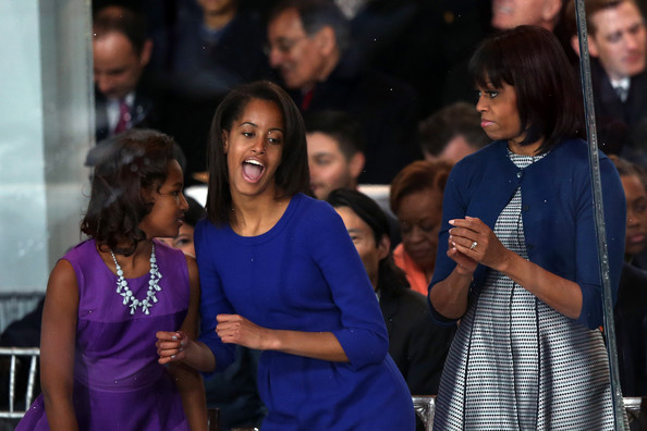 Michelle Obama Cardigan [inaugural parade held after swearing in ceremony,people,event,youth,community,fashion,crowd,adaptation,performance,ceremony,audience,michelle obama,malia obama,c,sasha obama,parade winds,capital,stand,nation,l]