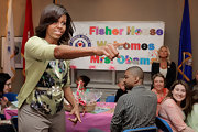 Michelle Obama glammed up her casual ensemble with a bejeweled belt during a pre-Easter celebration with military families.