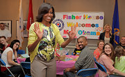 Michelle Obama wore a print silk blouse under a yellow cardigan during a pre-Easter celebration with military families.