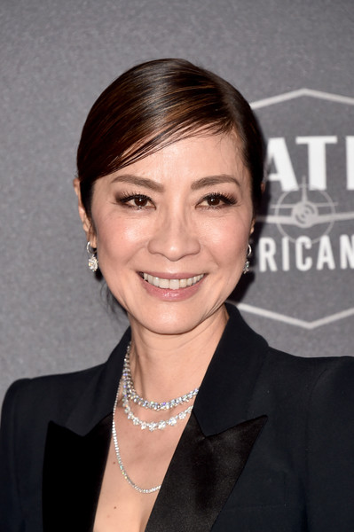 Michelle Yeoh Classic Bun [hair,hairstyle,eyebrow,forehead,chin,smile,white-collar worker,official,bangs,black hair,the beverly hilton hotel,beverly hills,california,22nd annual hollywood film awards - arrivals,annual hollywood film awards,michelle yeoh]