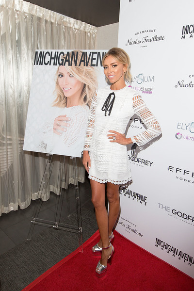 Giuliana Rancic was breezy and chic in a white Alexis mini dress with black bow detailing at the Michigan Avenue Spring Fashion issue celebration.