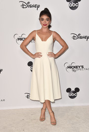 Sarah Hyland looked simply elegant in an ivory spaghetti-strap cocktail dress by Christian Siriano at Mickey's 90th Spectacular.