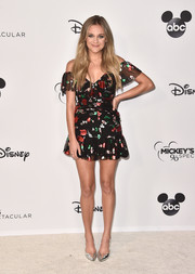 Kelsea Ballerini flaunted her gorgeous legs in an off-the-shoulder mini dress at Mickey's 90th Spectacular.