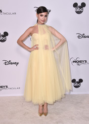 Sofia Carson looked regal in a caped yellow tulle gown by Monique Lhuillier at Mickey's 90th Spectacular.