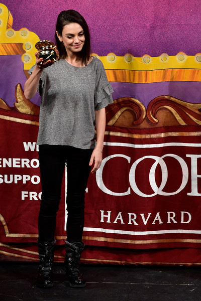 Mila Kunis Ruffle Blouse [mila kunis,hasty pudding theatricals,woman of the year,talent show,fashion,performance,footwear,font,event,stage,cambridge,massachusetts]