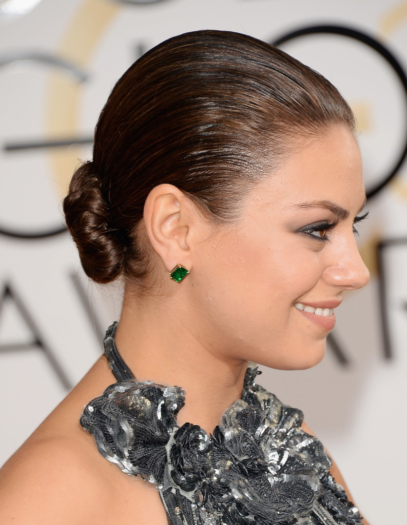 Mila kunis updos mila kunis hair stylebistro mila kunis polished off her look with a tight bun when she attended the golden globes pmusecretfo Image collections