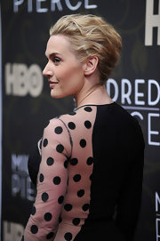 Kate Winslet allowed her sheer polka dot dress to take center stage with a textured French twist that was pinned into place.