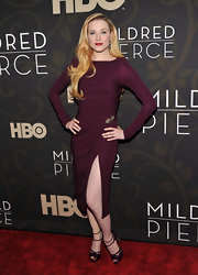 Evan Rachel Wood dazzled at the premiere of 'Mildred Pierce' in strappy plum platform Fall 2011 sandals.