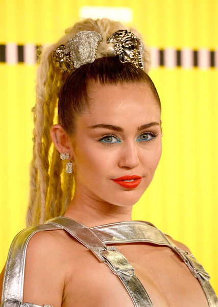 Miley Cyrus Ponytail [hair,headpiece,hair accessory,hairstyle,yellow,beauty,lady,chin,fashion accessory,lip,arrivals,miley cyrus,mtv video music awards,microsoft theater,los angeles,california]