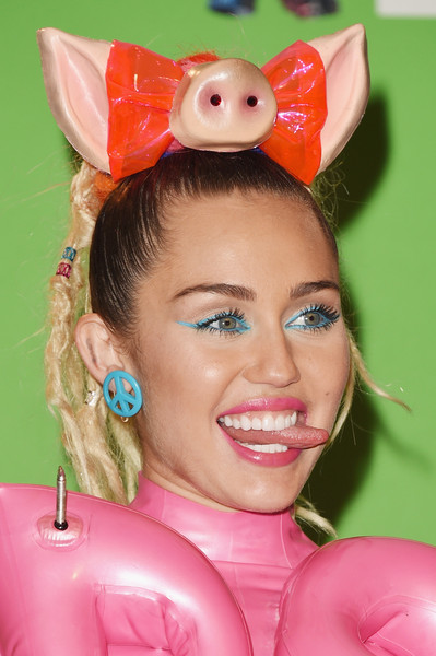 Miley Cyrus Bright Eyeshadow [miley cyrus,mtv video music awards,ear,pink,lip,headgear,costume hat,smile,costume accessory,mouth,costume,room,press room,california,los angeles,microsoft theater]