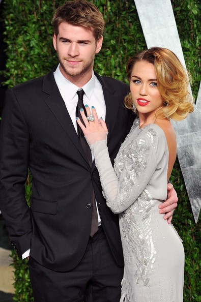 Miley Cyrus Bright Nail Polish [oscar party,vanity fair,l,suit,formal wear,photograph,clothing,tuxedo,dress,gown,hairstyle,fashion,event,sunset tower,west hollywood,california,liam hemsworth,miley cyrus,graydon carter - arrivals,actress]