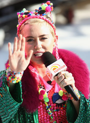 Miley Cyrus sported a gold cocktail ring along with some colorful beaded pieces while doing an interview in Sydney, Australia.