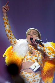 Miley Cyrus' Chanel bag added a luxe spot to her flashy ensemble during a performance in Perth, Australia.