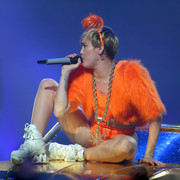Miley Cyrus got heavily blinged up with an oversized weed leaf pendant.