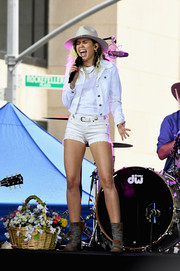 Miley Cyrus was uncharacteristically low-key in a white denim jacket layered over a matching tee while performing on NBC's 'Today.'