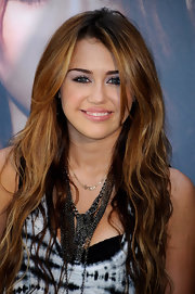 Miley Cyrus paired her tye-dyed tank top with a gang of layered chains.