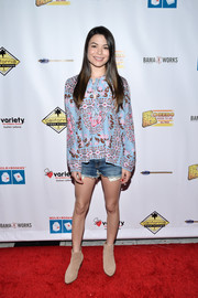 Miranda Cosgrove chose a floral-print tunic for her Milk + Bookies Story Time celebration look.
