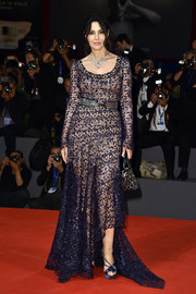 Monica Bellucci attended the Venice Film Festival premiere of 'On the Milky Road' looking ageless in a navy Azzedine Alaïa lace gown with an asymmetrical hem and a nude underlay.