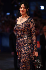 Monica Bellucci toughened up her elegant gown with a studded tote for the Venice Film Festival premiere of 'On the Milky Road.'
