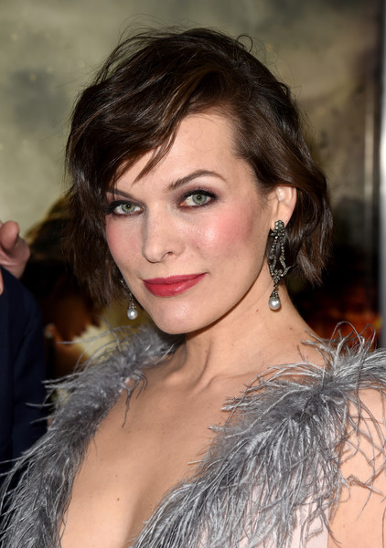 Milla Jovovich Short Wavy Cut [resident evil: the final chapter,hair,eyebrow,face,hairstyle,lip,chin,beauty,long hair,brown hair,black hair,milla jovovich,regal l.a. live theatres,california,los angeles,sony pictures releasing,red carpet,premiere]