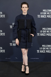 Claire Foy donned a utilitarian-chic navy and black mini dress for the 'Girl in the Spider's Web' photocall in Madrid.