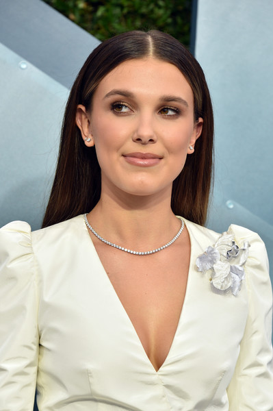 Millie Bobby Brown Long Straight Cut [lady,skin,beauty,white-collar worker,long hair,arrivals,millie bobby brown,screen actors guild awards,screen actors\u00e2 guild awards,los angeles,california,the shrine auditorium,millie bobby brown,screen actors guild awards,stranger things,shrine auditorium and expo hall,sag-aftra,actor,2020,photograph]