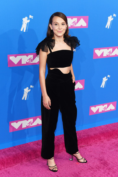 Millie Bobby Brown High-Waisted Pants [blue,flooring,carpet,shoulder,red carpet,girl,fashion model,electric blue,long hair,joint,arrivals,millie bobby brown,mtv video music awards,new york city,radio city music hall,ariana grande,2018 mtv video music awards,radio city music hall,video,mtv video music award,red carpet,celebrity,music,mtv]