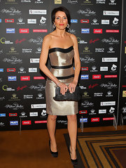 Dannii Minogue attended the Million Dollar Lunch fundraiser wearing a metallic gold dress with black accents.