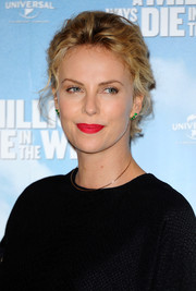 Charlize Theron wore her short hair pulled back with mussed-up waves during the photocall for 'A Million Ways to Die in the West.'