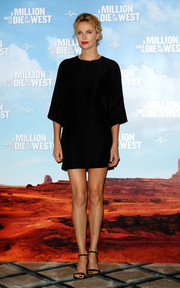 Charlize Theron kept it simple all the way down to her black ankle-strap sandals.