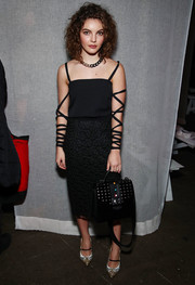 A black tote with a studded flap rounded out Camren Bicondova's ensemble.