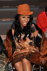 June Ambrose wore a newsboy cap at the front row of Fall 2013 MBFW.