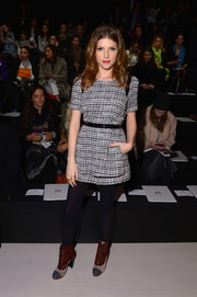 Anna Kendrick added warmth to her mini dress with a pair of black tights.