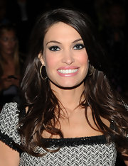 Kimberly Guilfoyle's thick brown tresses looked gorgeous, as usual, in a side part and subtle waves.