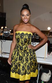 Tika Sumpter looked oh-so-sweet in a yellow and black floral strapless dress at the Milly by Michelle Smith fashion show.