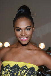 Tika Sumpter styled her hair in a sleek top knot for the Milly by Michelle Smith fashion show.