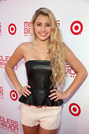 Lia Marie Johnson opted for a black leather peplum top for her red carpet look at the 'All Around the World' premiere.
