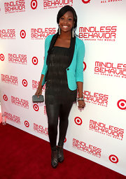 Coco Jones chose a fringe tiered dress reminiscent of the '20s for her red carpet look.