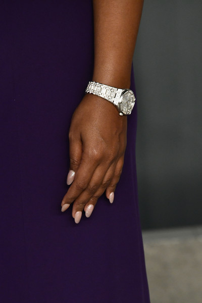 Mindy Kaling Diamond Watch [bracelet,jewellery,purple,hand,finger,bangle,fashion accessory,nail,pearl,dress,radhika jones - arrivals,radhika jones,mindy kaling,detail,beverly hills,california,wallis annenberg center for the performing arts,oscar party,vanity fair,stock photography,shutterstock,image,photograph,ring,hand model,nail,silver,watch]