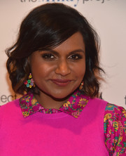 Mindy Kaling went all out with the colors, teaming a pair of multi-hued gemstone chandelier earrings with her hot-pink outfit.