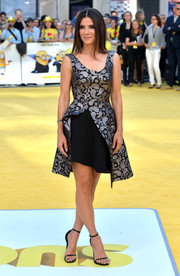 Sandra Bullock complemented her frock with on-trend slim-strap sandals by Saint Laurent.