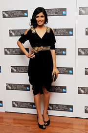 Freida Pinto paired her Resort 2011 embellished dress with stunning Stitched leather peep toe pumps.