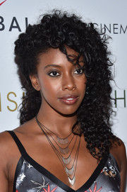 Condola Rashad attended the screening of 'Southside with You' wearing her hair in a half-pinned curly style.