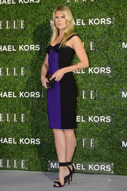 Alexandra Richards was sporty-sexy in a blue and black corset dress during the Elle Japan December cover celebration.