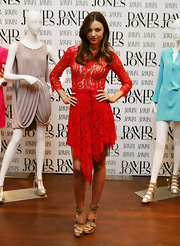 Australian beauty Miranda Kerr rocked a red lacy David Jones dress that she paired with loose sun-kissed waves.