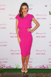Miranda Kerr brought a jolt of color to the Royal Albert teaware event with this magenta cropped-overlay dress by Victoria Beckham.